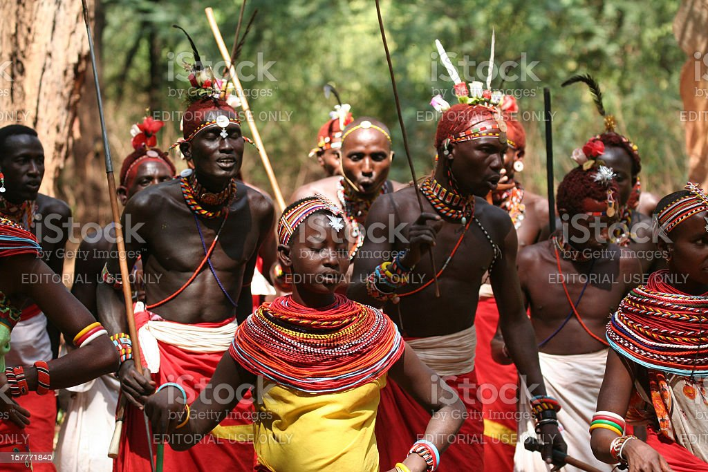 Samburu girls dancing with a group of morani (warriors) Kenya stock photo