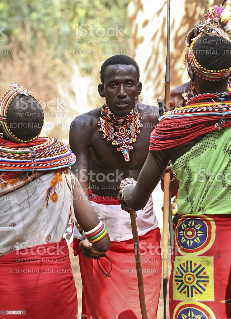 Samburu moranis (warriors) and girls performing traditional dance. stock photo