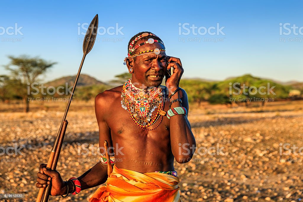 Samburu tribe warrior using mobile phone, central Kenya, East Africa stock photo