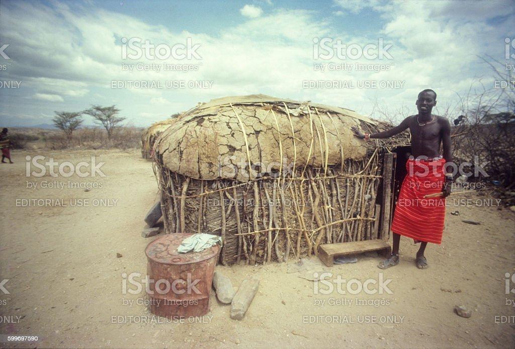 Samburu warrior in manyatta near Archers Post, Samburu Reserve, stock photo