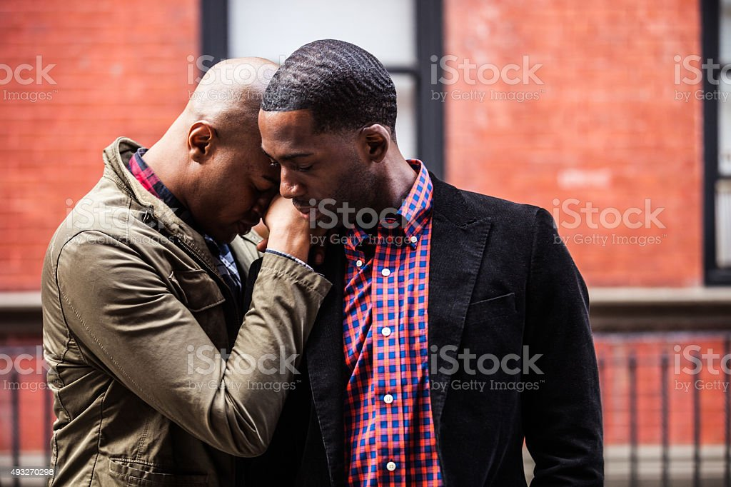 Same sex couple posing in New York city streets stock photo