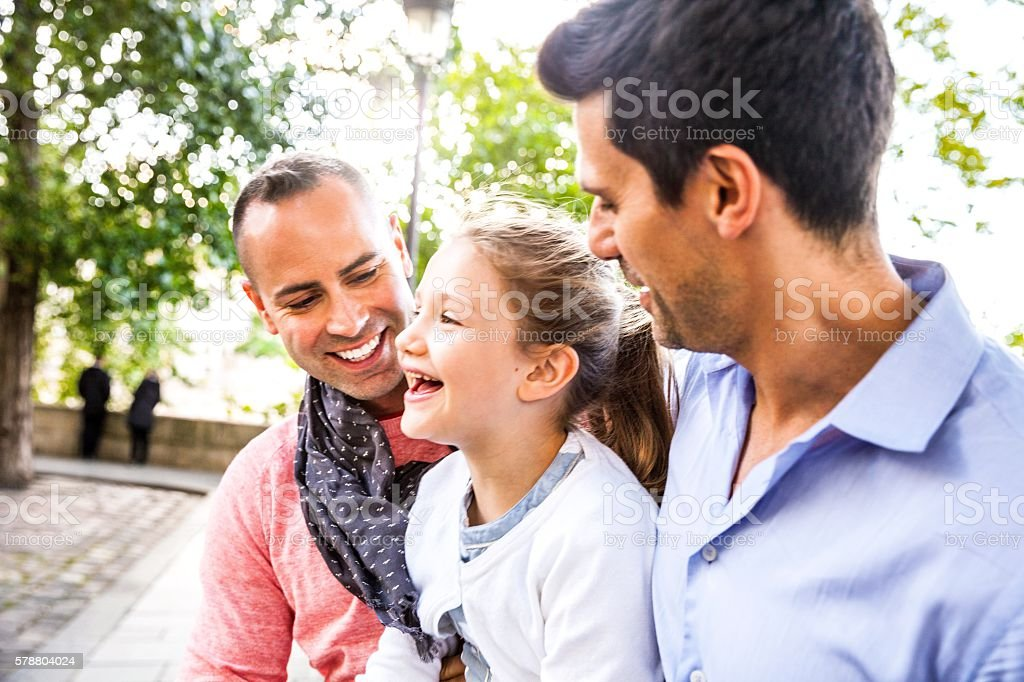 Same sex family spending a day outdoor in Paris downtown stock photo