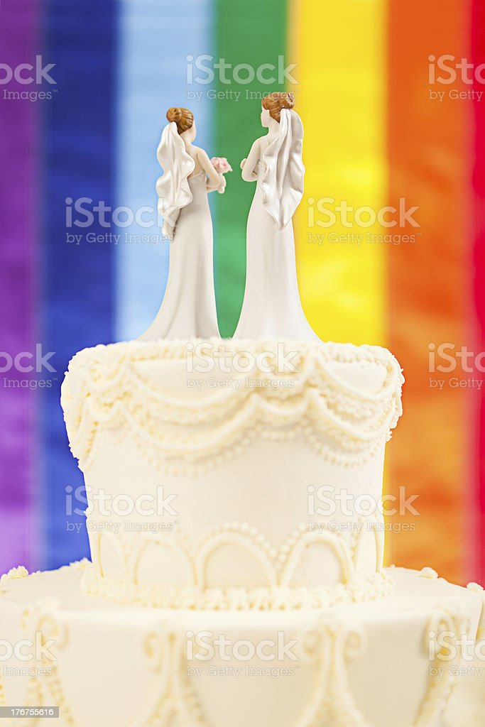 Same Sex Marriage Brides Wedding Cake with Rainbow Flag stock photo