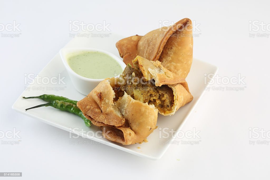 samosa with fresh mint dipping sauce stock photo