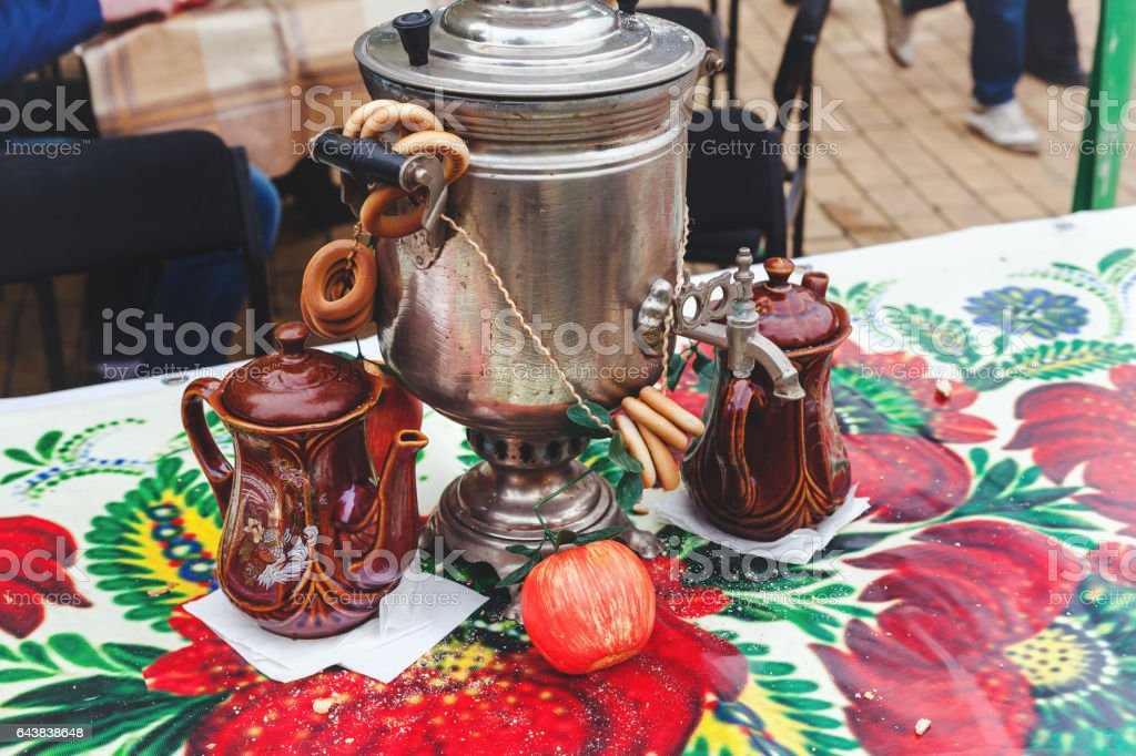 Samovar, bagels and tea on bright tablecloth on Russian holiday carnival Maslenitsa stock photo