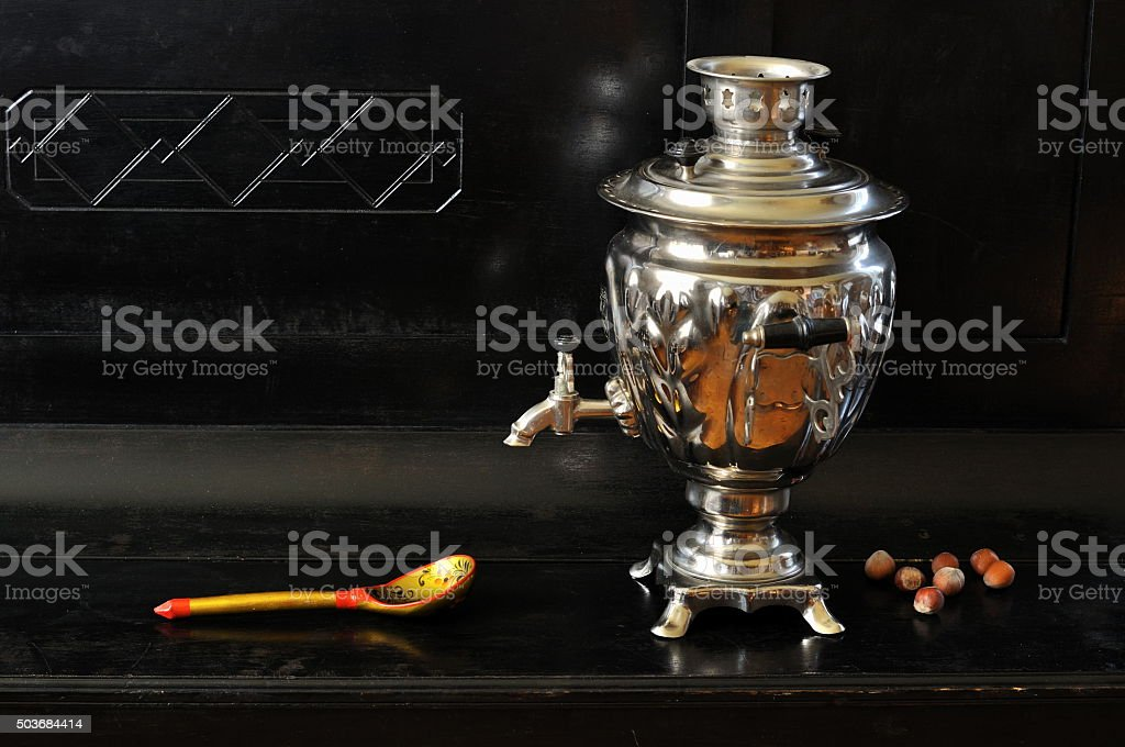 Samovar, hazelnuts and decorated wooden spoon stock photo