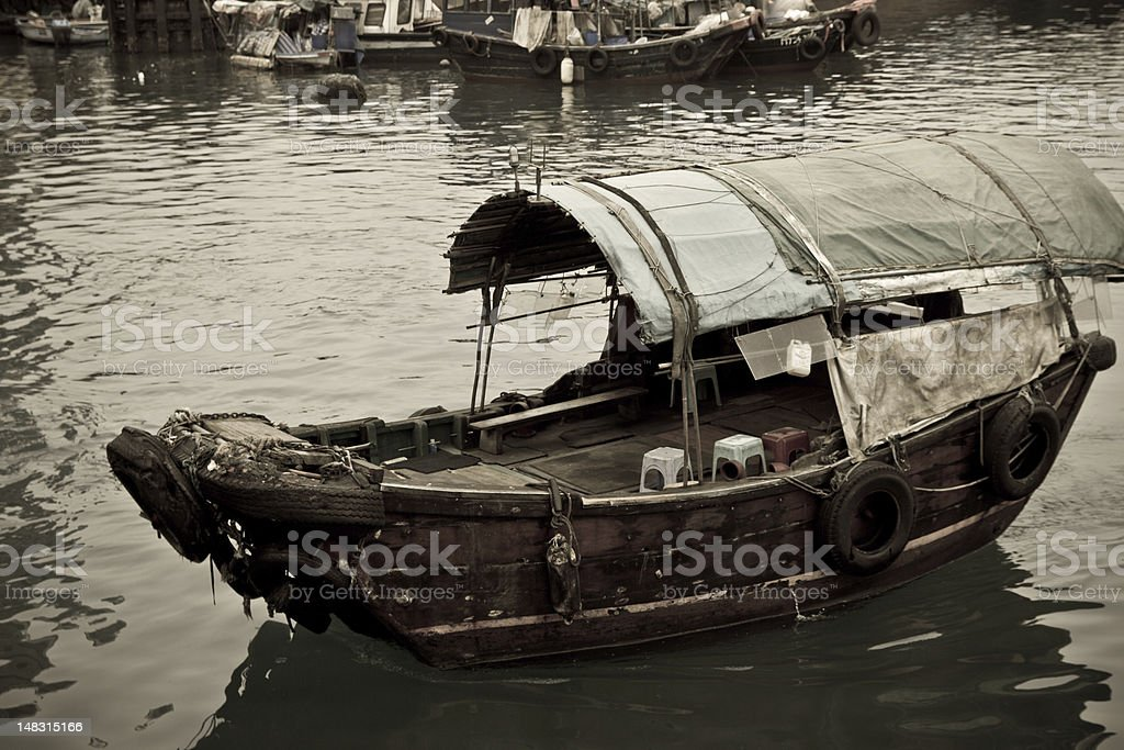 Sampan boat floating in the sea royalty-free stock photo