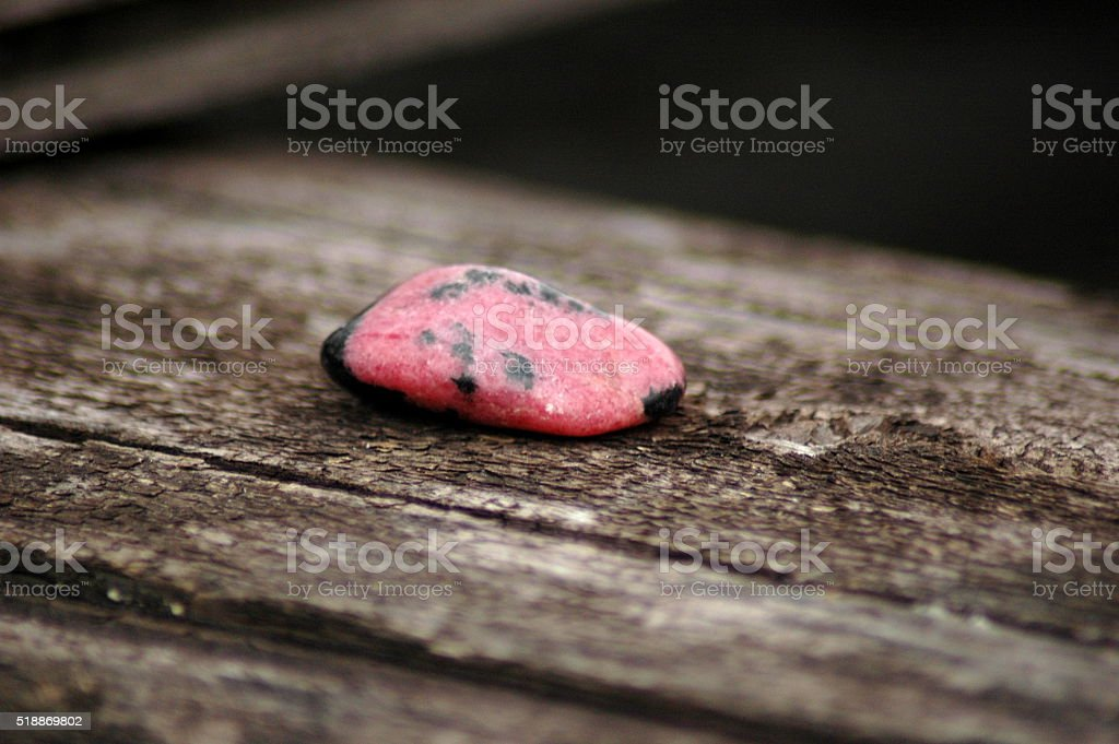Sample of a polished rhodonite stone stock photo