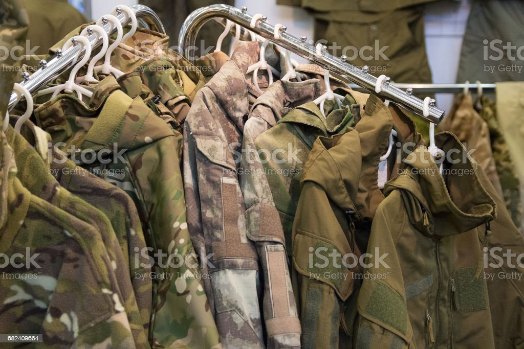 Samples camouflage military clothes in the store stock photo