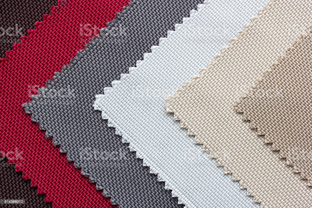 Samples of colored canvas fabric background stock photo
