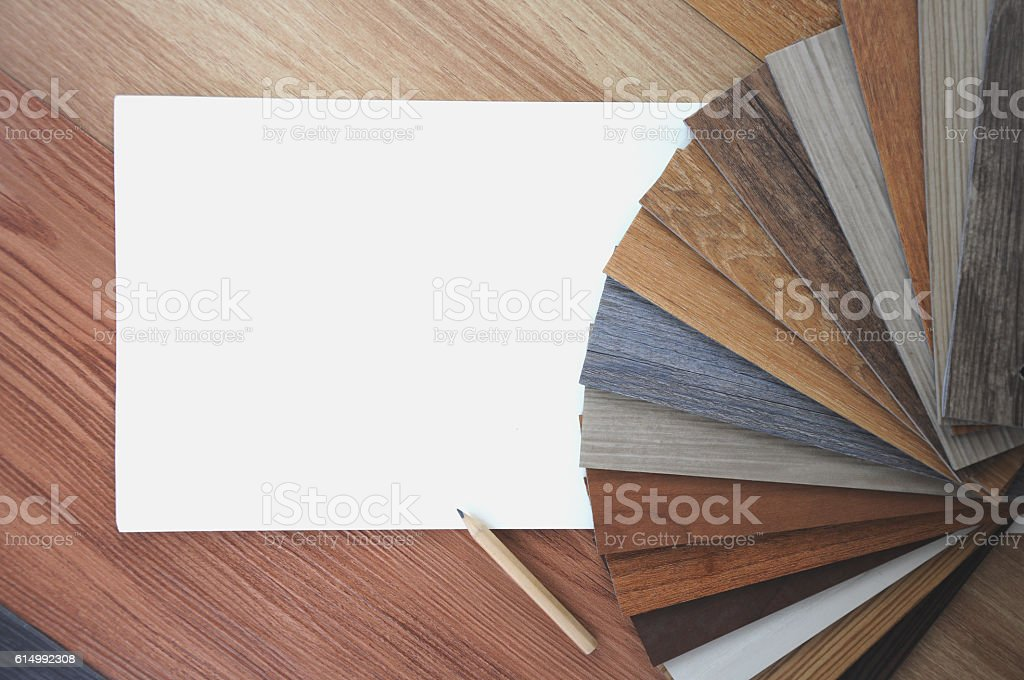 Samples of laminate and vinyl floor tile on wooden Background stock photo