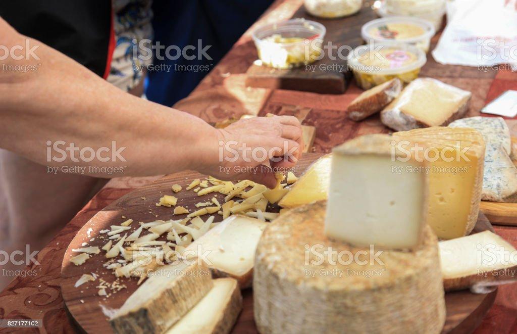 Sampling Cheese at Farmer's Market stock photo