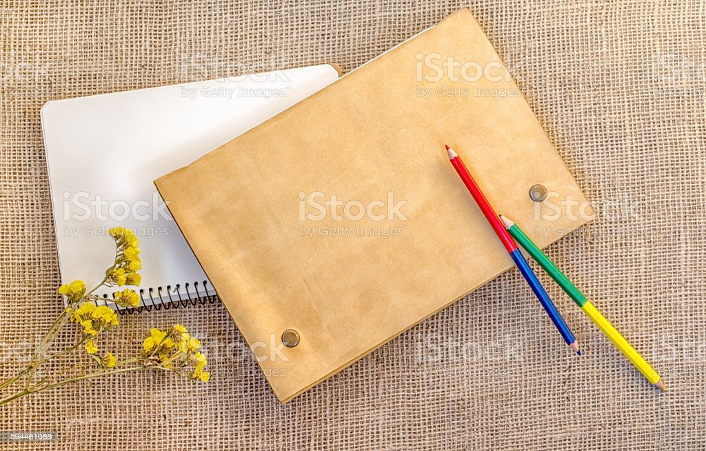 Sampling of stationery - notebook, folder and pencils stock photo