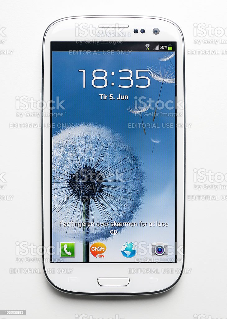 Samsung Galaxy S3 aa smartphone on white table stock photo