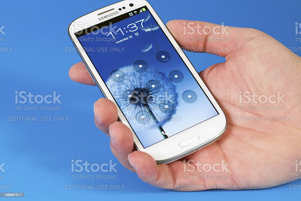 Samsung Galaxy S3 in hand stock photo