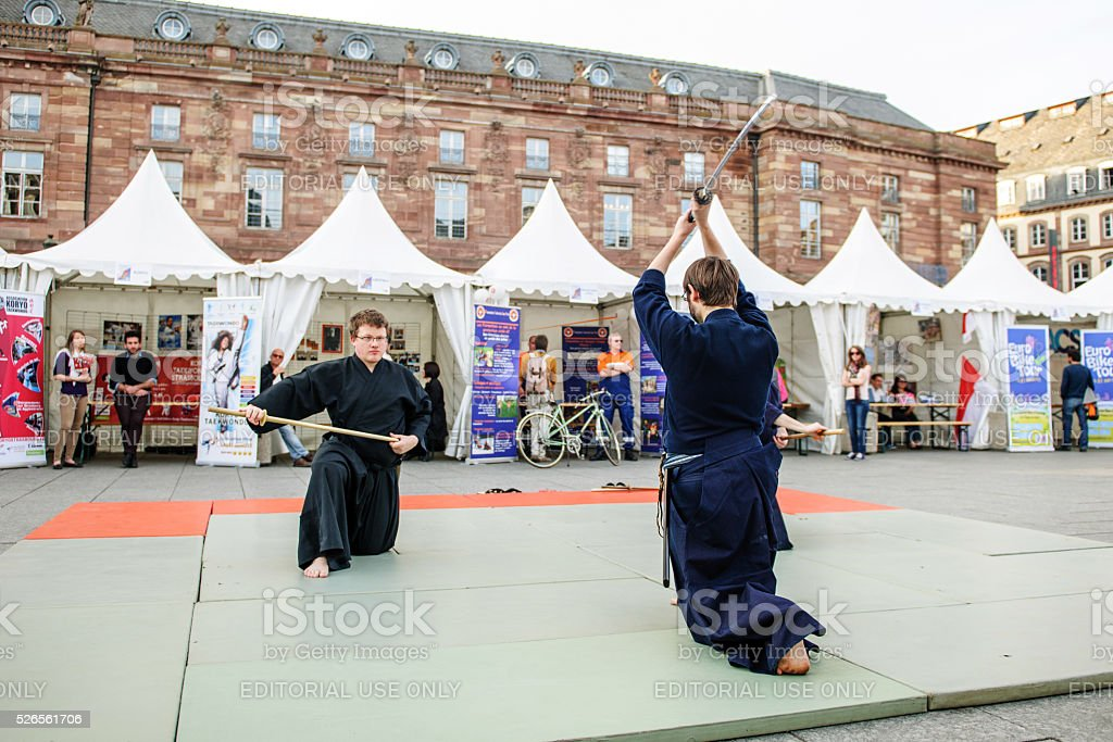 Samurai fight center of city performance stock photo