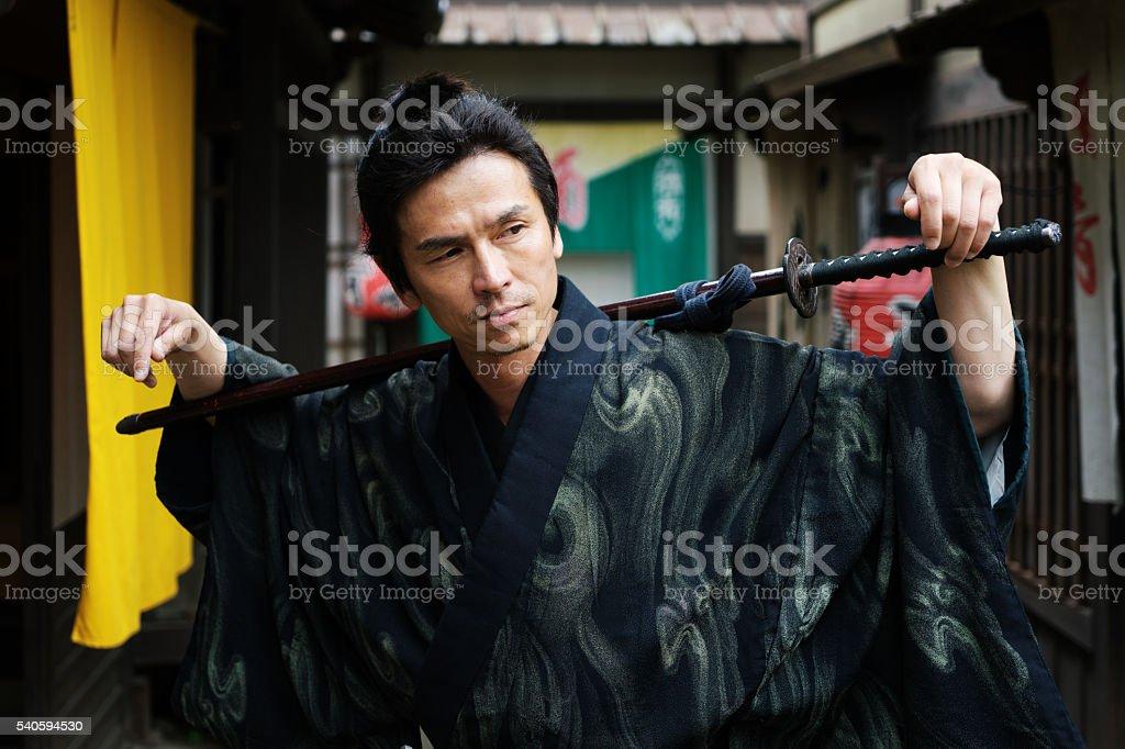 Samurai Posing In Traditional Japanese Village stock photo