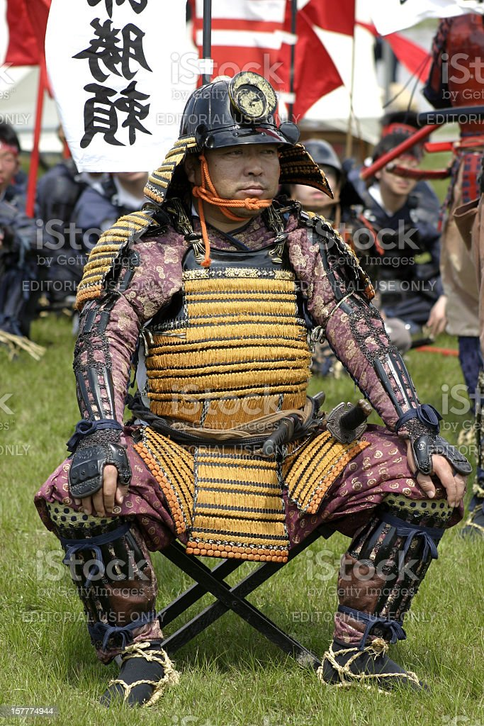 Samurai sitting in front of his warriors stock photo