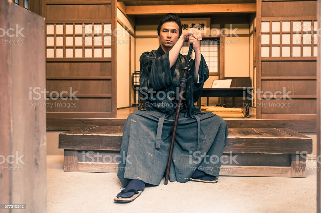 Samurai sitting with his katana stock photo