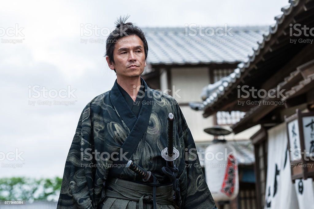 , Samurai walk in the middle of a village street stock photo