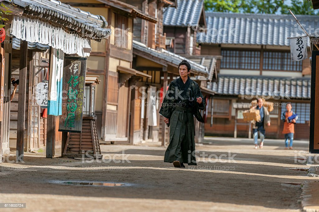 Samurai walk in the middle of a village street,Kyoto stock photo