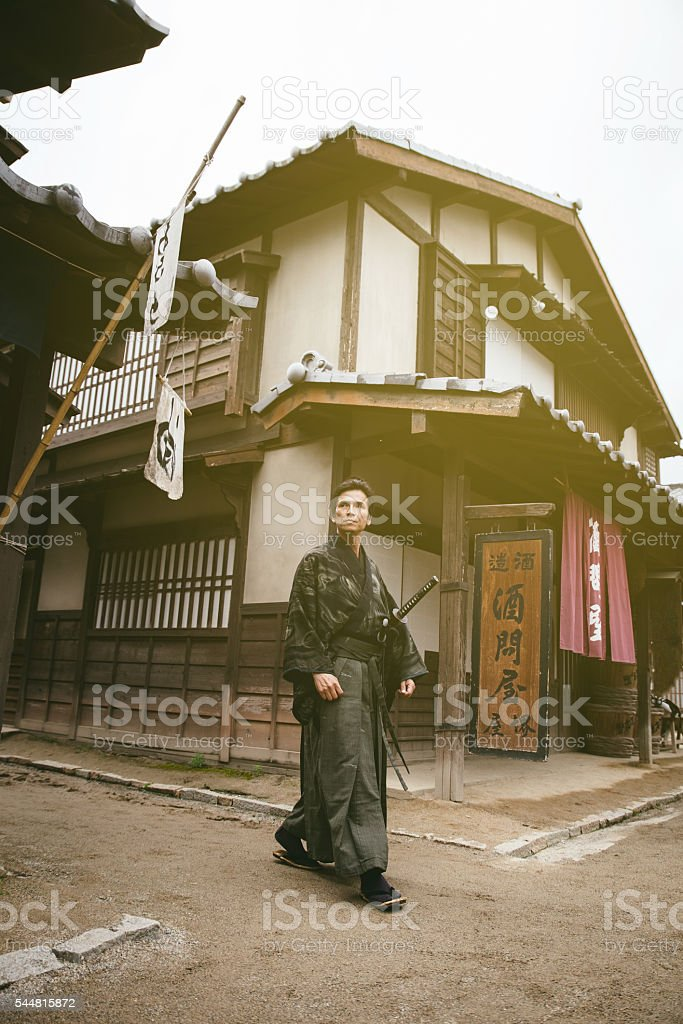 Samurai walking down the village street stock photo