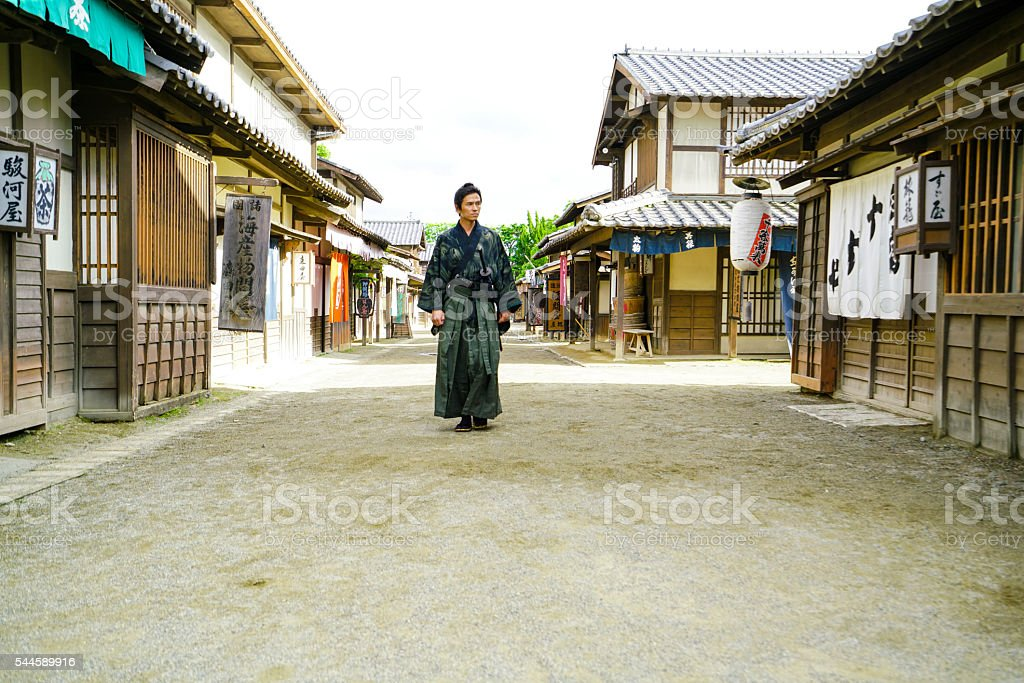 Samurai warrior with Sword on an old street in Japan stock photo