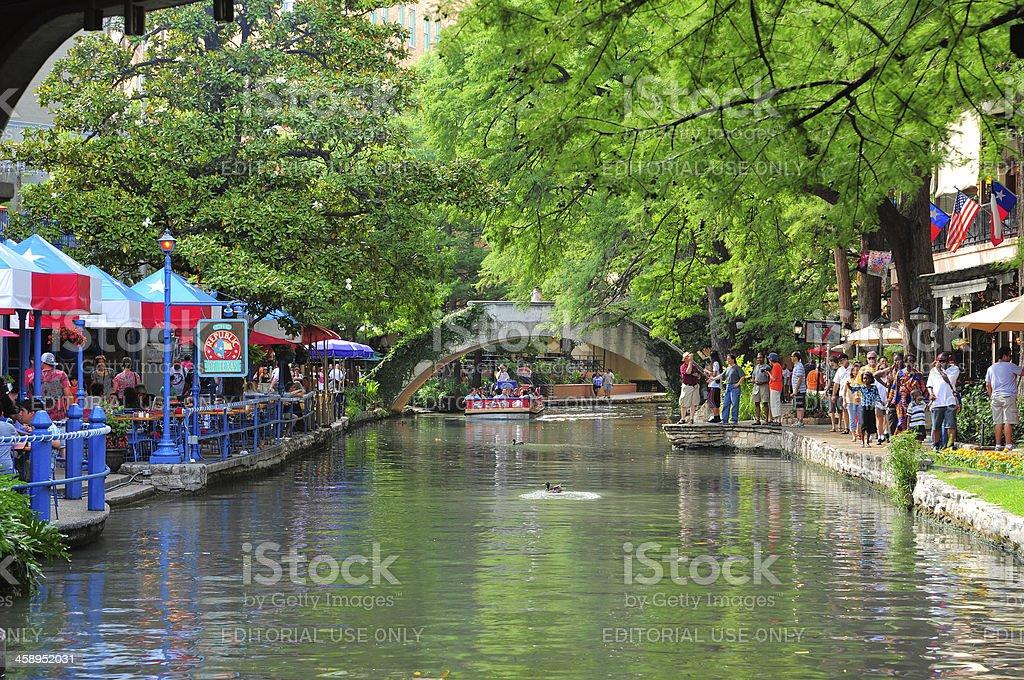 San Antonio Riverwalk river, crowds of people, and trees stock photo