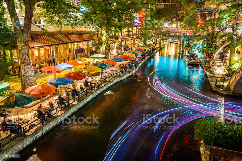 San Antonio Riverwalk, Texas, scenic river canal tourism umbrellas night stock photo