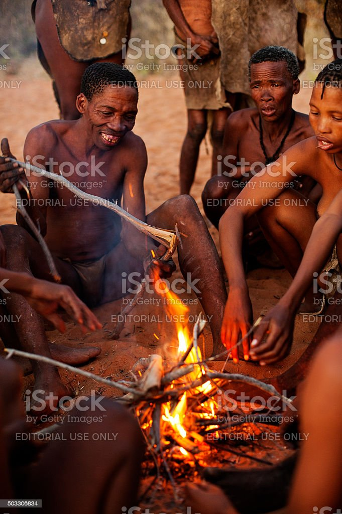 San bushmen people making fire, Grashoek, Namibia stock photo
