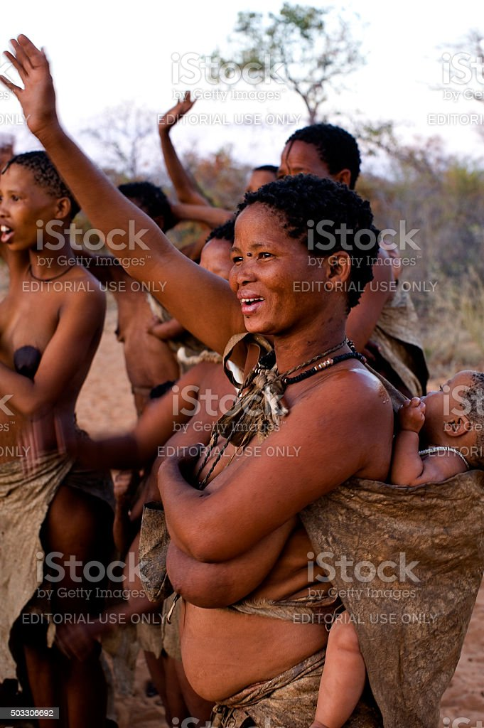 San bushmen woman with baby on his back, Grashoek, Namibia stock photo