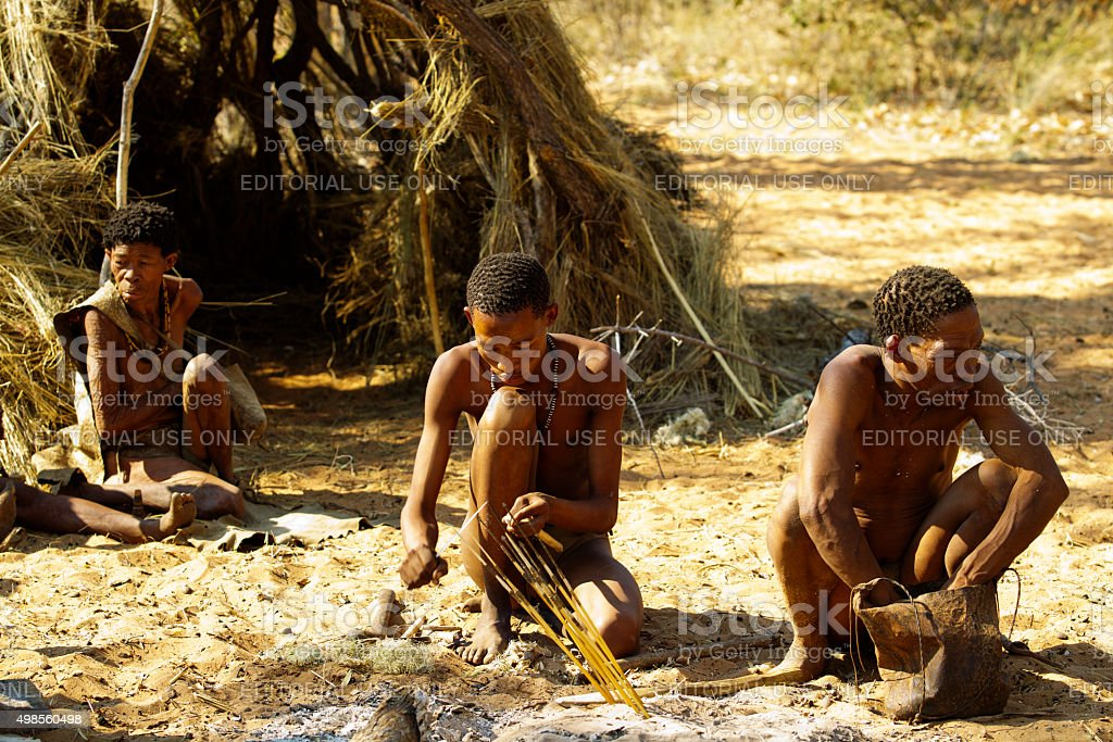 San bushmens in front of his very primtive hut, Namibia stock photo