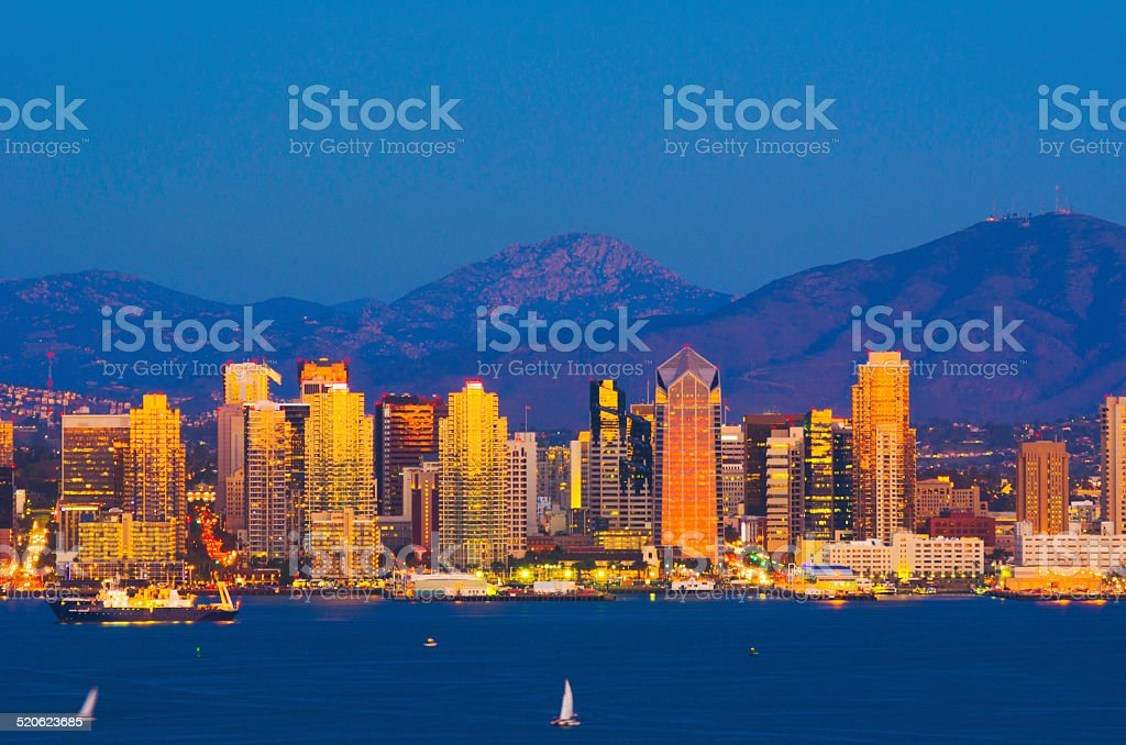 San Diego skyline with golden and orange reflections at sunset stock photo