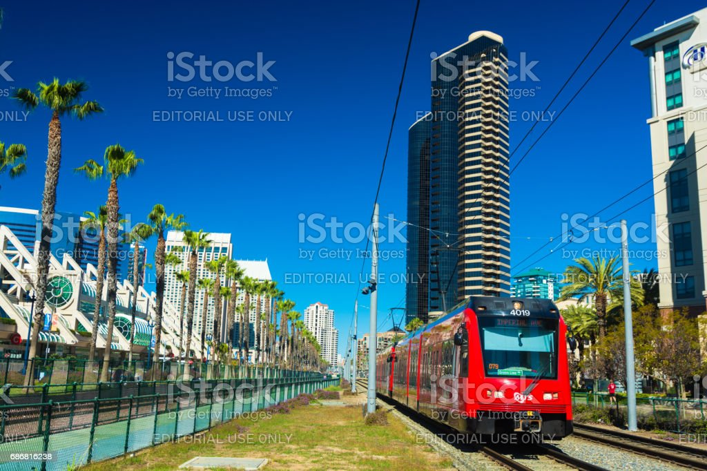 San Diego Trolley, Palm Trees, and Marina District Buildings stock photo