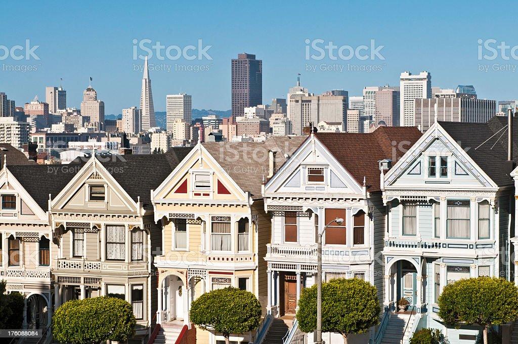 San Francisco Alamo Square Postcard Row houses downtown skyscraper cityscape stock photo