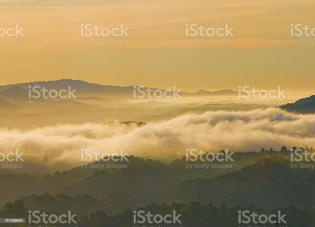 San Francisco Area: Dawn Fog over East bay Hills stock photo