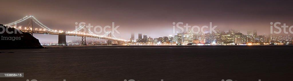 San Francisco Bay Before Sunrise Fog Sticking to Bridge Skyline stock photo