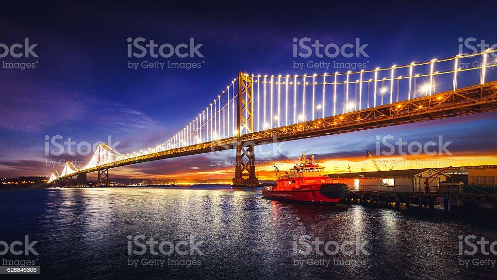 San Francisco Bay Bridge Illuminated at Sunrise stock photo