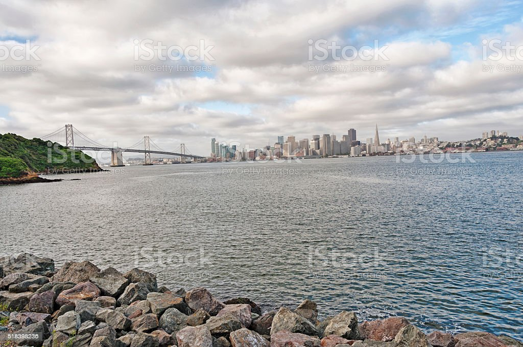San Francisco Cityscape and Bay Bridge on a Cloudy Day stock photo