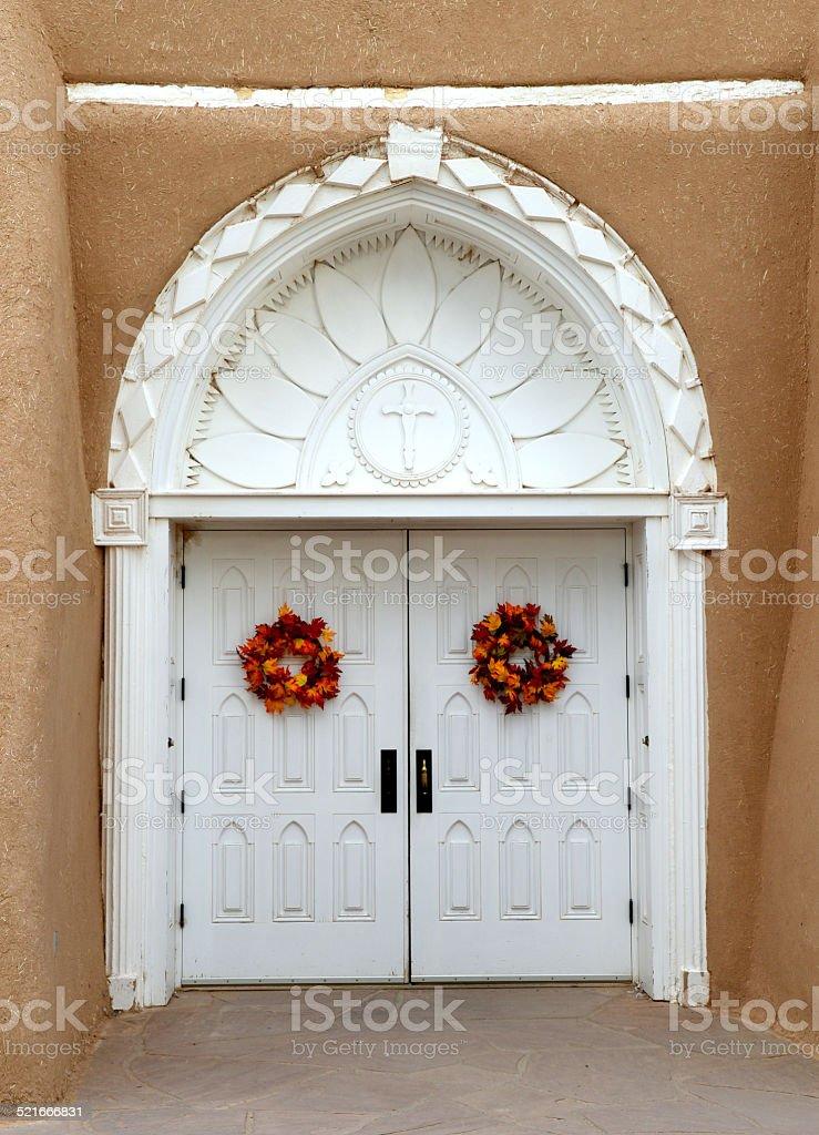 San Francisco de Asis Church door in Taos, Mew Mexico stock photo