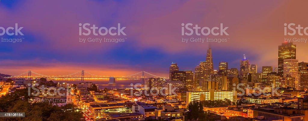 San Francisco downtown and Bay Bridge under low fog Panorama stock photo