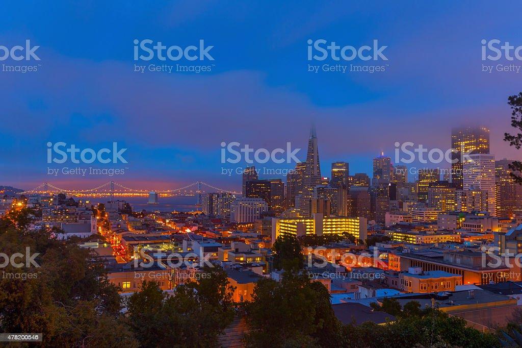 San Francisco downtown and Bay Bridge under low fog stock photo