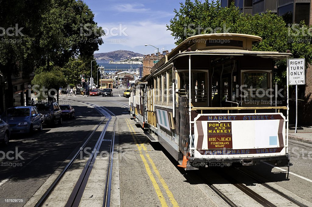 San Francisco historic cable car overlooking bay pier Alcatraz Island stock photo