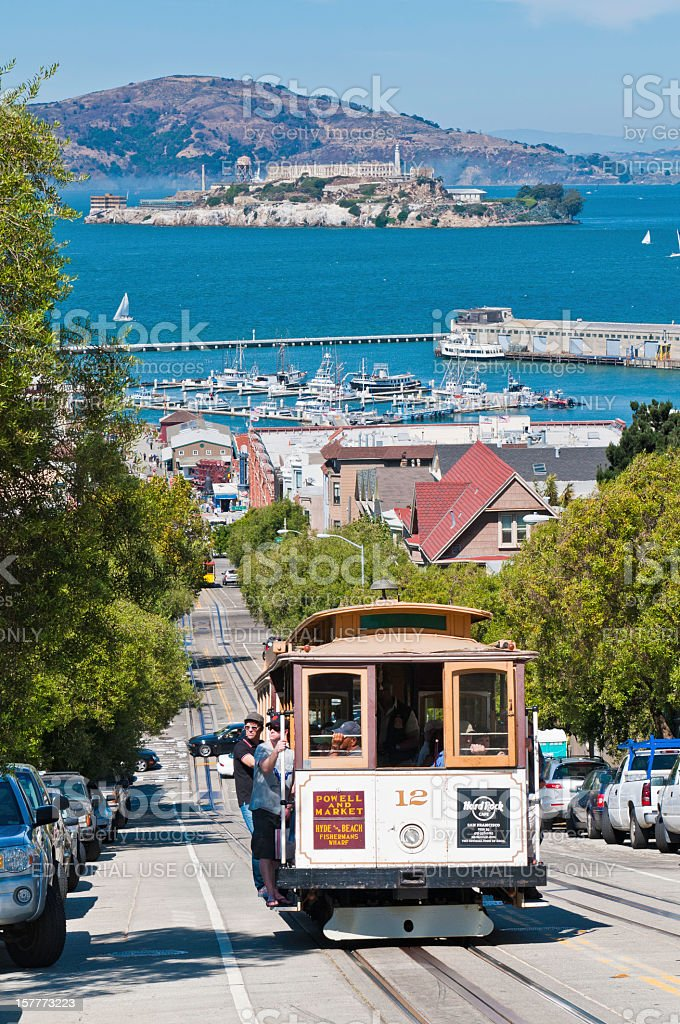 San Francisco iconic cable car with tourists California USA stock photo
