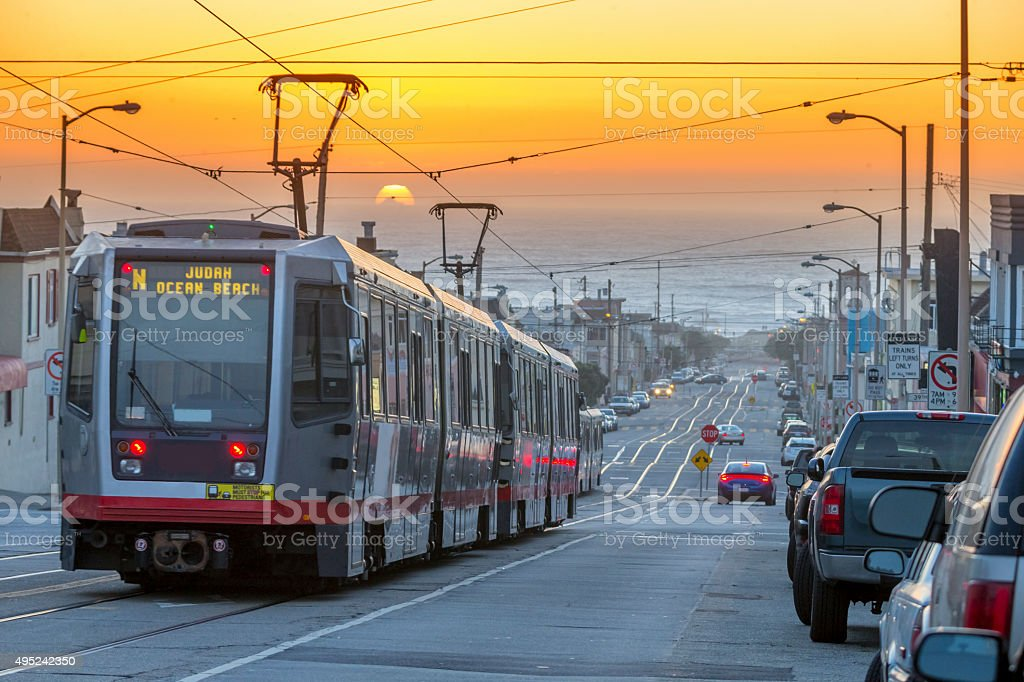 San Francisco lightrail drive to  the sea under Sunset stock photo