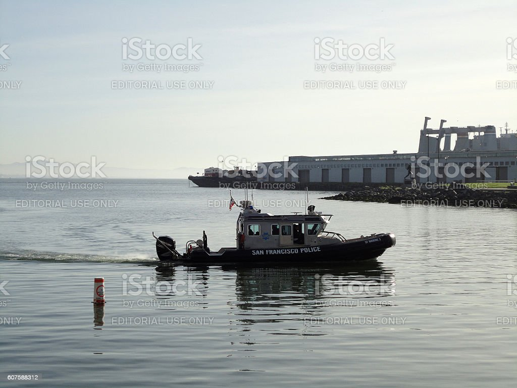 San Francisco Police boat cruise though McCovey Cove stock photo