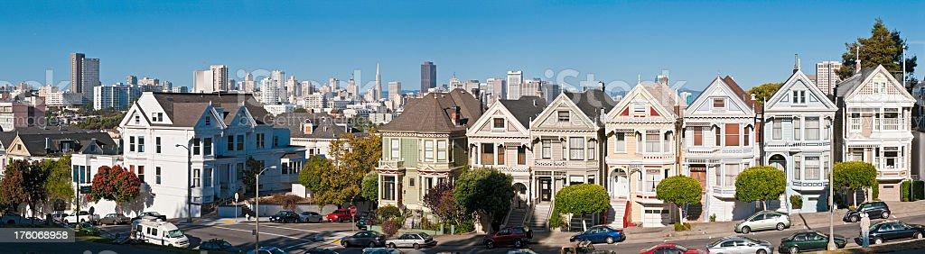 San Francisco Postcard Row Alamo Square Victorian houses skyline panorama stock photo