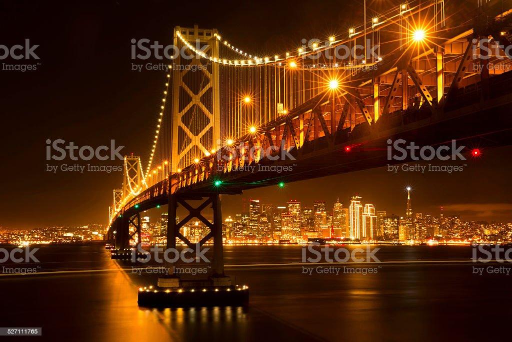 San Francisco skyline and Bay Bridge at night stock photo