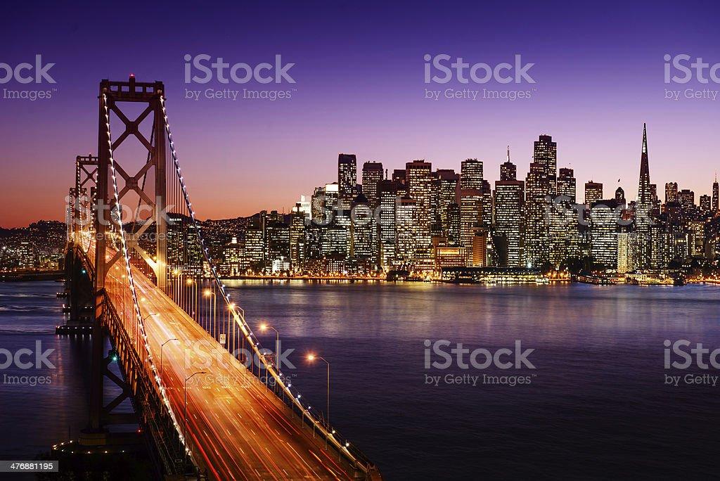 San Francisco skyline and Bay Bridge at sunset, California stock photo