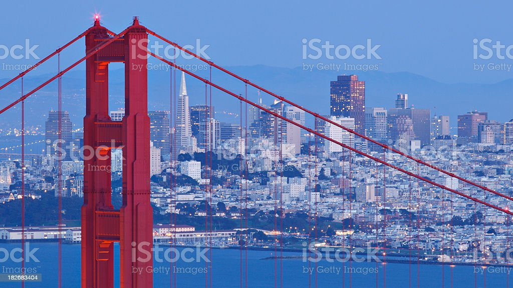 San Francisco skyline through Brooklyn bridge at dusk royalty-free stock photo